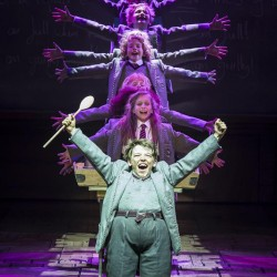 Harrison Vaughan as Bruce, Lizzie Wells as Matilda and the company - Matilda The Musical